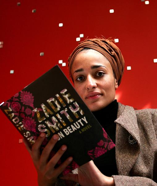 """FILE - In this Sept. 19, 2005 file photo, British author Zadie Smith poses with her book, """"On Beauty"""" in London. The lineup of 20 writers under 40 announced Monday April 15, 2013 included newcomer Taiye Selasi and established best-seller Zadie Smith who have been named to Granta magazine's list of best young British novelists _ a once-a-decade roster with a reputation for predicting literary stars. (AP Photo/Sergio Dionisio, File)"""
