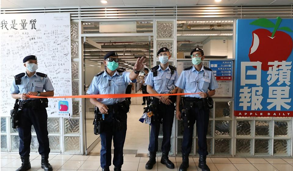 Police raided the Apple Daily offices on Monday. Photo: Reuters