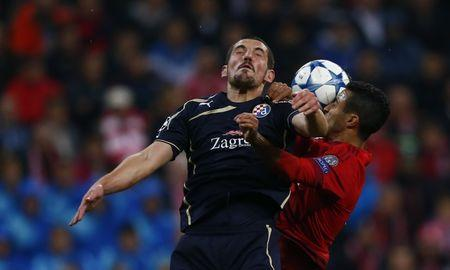 Dinamo Zagreb's Ademi goes for a header with Bayern Munich's Alcantara during their Champions League Group F soccer match in Munich