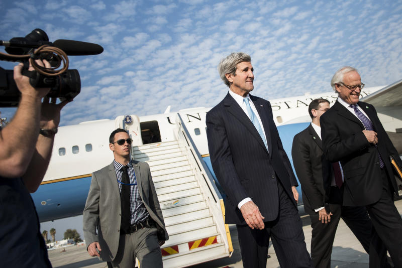 U.S. Secretary of State John Kerry arrives at Ben Gurion airport near Tel Aviv, Israel, Thursday, Jan. 2, 2014. Kerry arrived Thursday in Israel to broker Mideast peace talks that are entering a difficult phase aimed at reaching a two-state solution between the Israelis and Palestinians. (AP Photo/Brendan Smialowski, Pool)