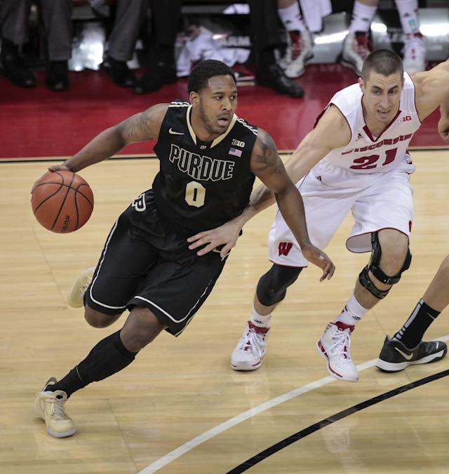 Purdues' Terone Johnson (0) drives against Wisconsin's Josh Gasser during the first half of an NCAA college basketball game Wednesday, March 5, 2014, in Madison, Wis. (AP Photo/Andy Manis)