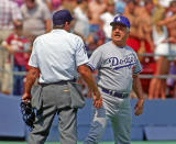 Manger Tommy Lasorda of the Los Angeles Dodgers argues with Major League Baseball umpire Ed Montague during a game against the Pittsburgh Pirates at Three Rivers Stadium circa 1987 in Pittsburgh, Pennsylvania. (Photo by George Gojkovich/Getty Images)