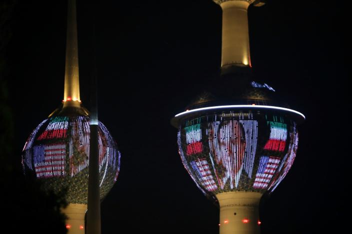 Kuwait's Towers in Kuwait City are illuminated in the colors of the American flag and a portrait of former President George H.W. Bush on Dec. 1, in tribute to the late U.S. leader. (Photo: Yasser Al-Zayyat/AFP/Getty Images)