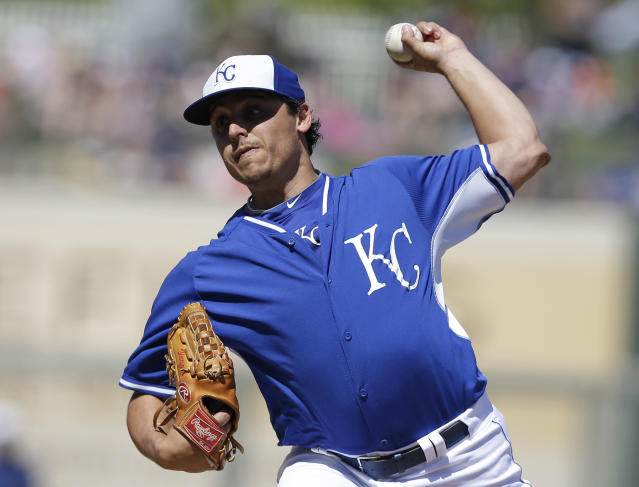 Kansas City Royals starting pitcher Jason Vargas throws during the third inning of a spring exhibition baseball game against the Texas Rangers, Saturday, March 22, 2014, in Surprise, Ariz. (AP Photo/Darron Cummings)