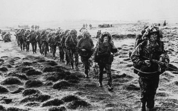 British soldiers advancing across East Falkland island for the final attack on Port Stanley during the Falklands War, June 1982 - Credit: Hulton Archive