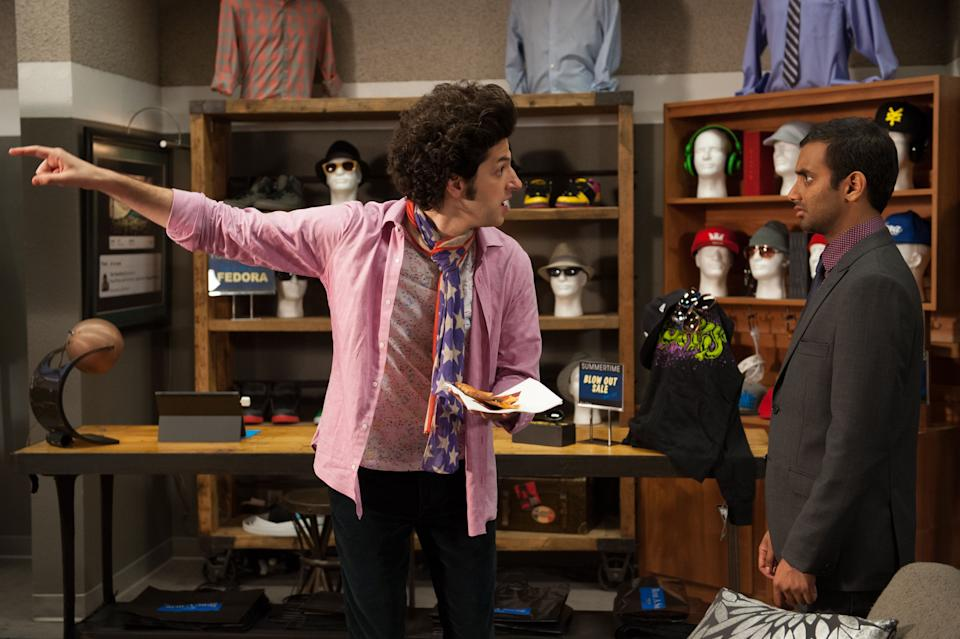 """PARKS AND RECREATION -- """"London"""" Episode 601/602 -- Pictured: (l-r) Ben Schwartz as Jean-Ralphio, Aziz Ansari as Tom Haverford -- (Photo by: Colleen Hayes/NBCU Photo Bank/NBCUniversal via Getty Images via Getty Images)"""