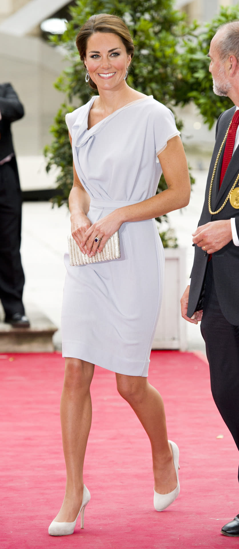 <p>Kate attended a formal reception in a dove grey Roksanda Ilincic ensemble. She paired the look with a beaded clutch and suede heels from L.K. Bennett.</p><p><i>[Photo: PA]</i></p>