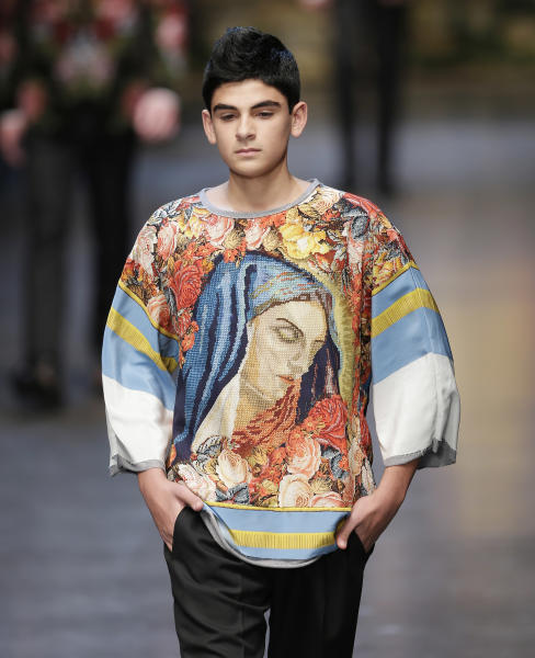 A model wears a creation of Dolce & Gabbana men's Fall-Winter 2013-14 collection, part of the Milan Fashion Week, unveiled in Milan, Italy, Saturday, Jan. 12, 2013. (AP Photo/Antonio Calanni)
