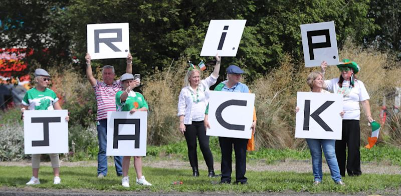 """Republic of Ireland fans gather to sing the Ireland world cup anthem """"Put em under pressure"""" at 12:30 Walkinstown Roundabout in Dublin as Jack Charltons funeral comes to a close in Newcastle"""