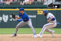 Texas Rangers' Isiah Kiner-Falefa is safe as Toronto Blue Jays third baseman Cavan Biggio waits for the late throw on an attempted fielder's choice during the eighth inning of a baseball game Monday, April 5, 2021, in Arlington, Texas. (AP Photo/Jeffrey McWhorter)
