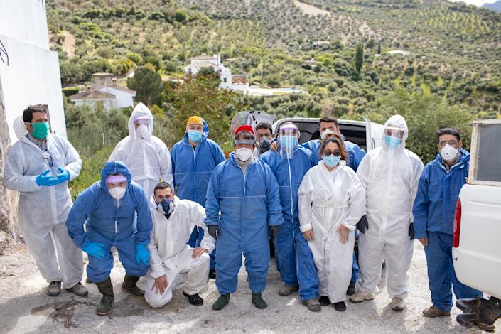 Volunteers pose before going to work to disinfect the town of Zahara de la Sierra. (Getty Images)