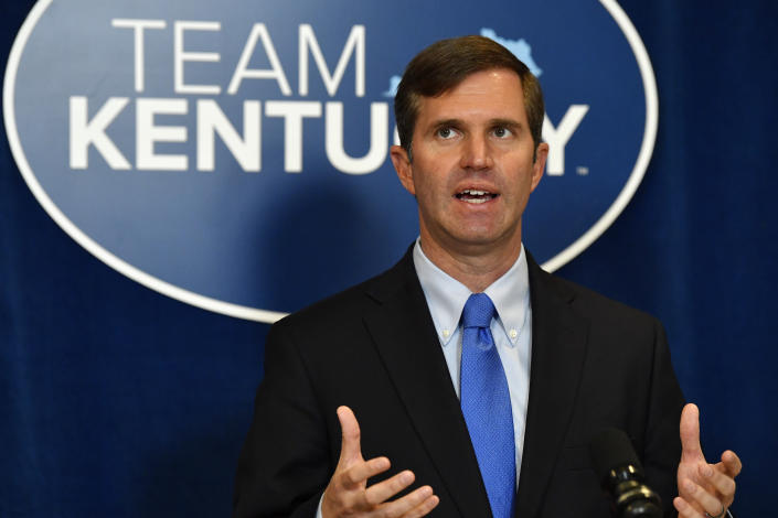 Kentucky Governor Andy Beshear speaks to reporters before the signing of bills related to the American Rescue Plan Act at the Kentucky State Capitol in Frankfort, Ky., Wednesday, April 7, 2021. (AP Photo/Timothy D. Easley)