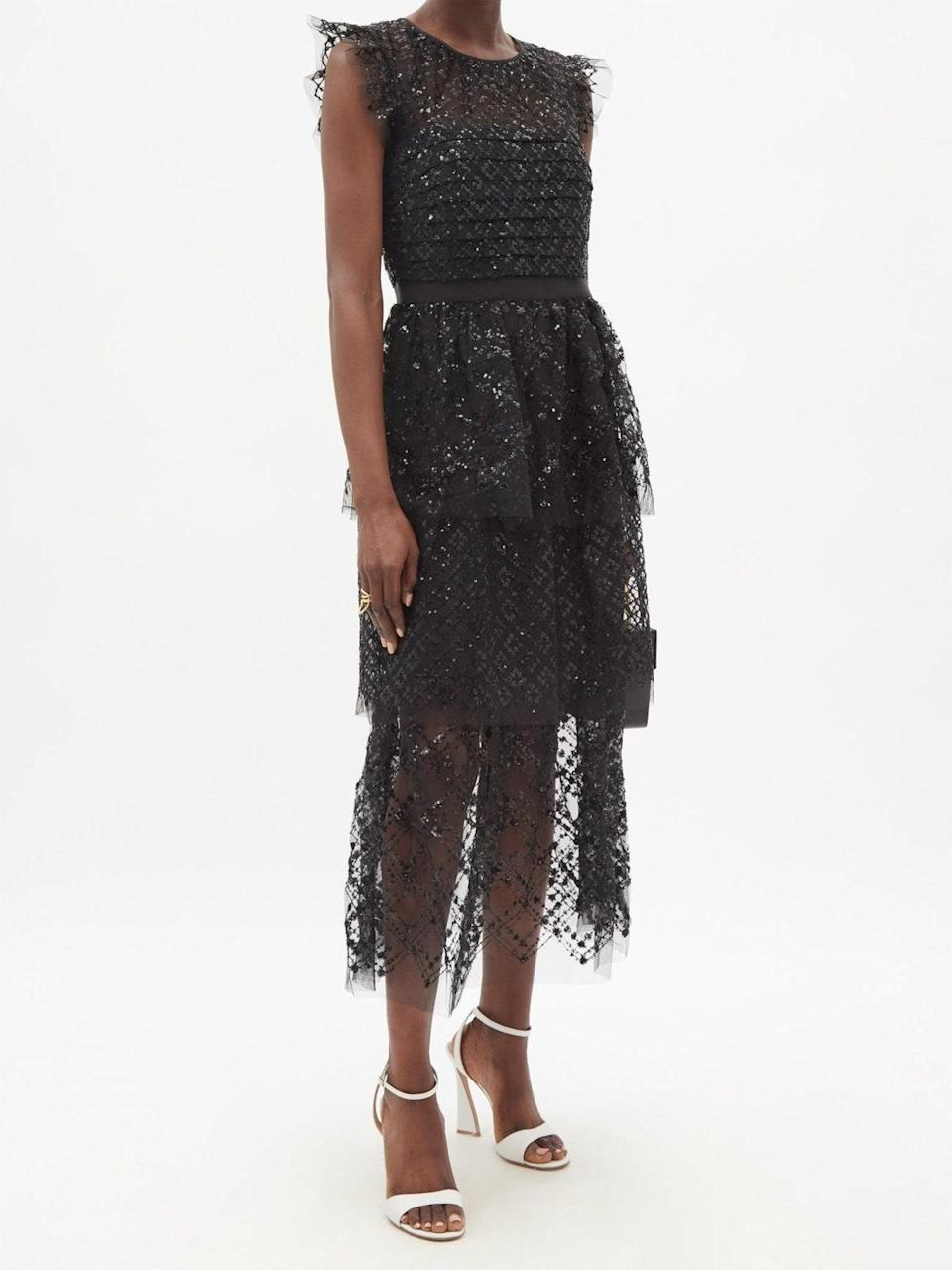 """Pixie fairy meets goth princess in this in tea-length beauty, complete with lace, chiffon ruffles, and fluttering short sleeves. $565, Matches Fashion. <a href=""""https://www.matchesfashion.com/us/products/Self-Portrait-Tiered-sequinned-chiffon-midi-dress-1436938"""" rel=""""nofollow noopener"""" target=""""_blank"""" data-ylk=""""slk:Get it now!"""" class=""""link rapid-noclick-resp"""">Get it now!</a>"""