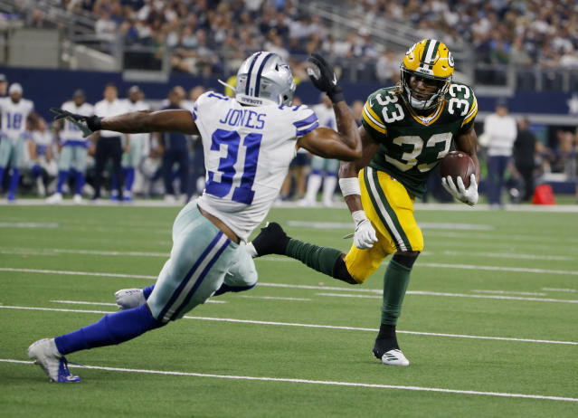 Dallas Cowboys cornerback Byron Jones (31) defends as Green Bay Packers running back Aaron Jones (33) sprints to the end zone for a touchdown during the second half of an NFL football game in Arlington, Texas, Sunday, Oct. 6, 2019. (AP Photo/Michael Ainsworth)