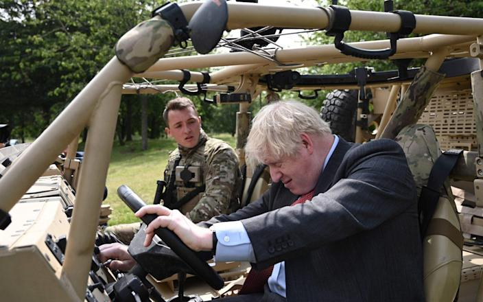 Boris impresses the troops with his driving skills... maybe - AFP