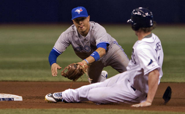 Toronto Blue Jays' Ryan Goins, left, reaches to tag out Tampa Bay Rays' Wil Myers who slides into second base during the sixth inning of a baseball game Thursday, Sept. 4, 2014, in St. Petersburg, Fla. Myers was trying to stretch a single into extra bases. (AP Photo/Steve Nesius)
