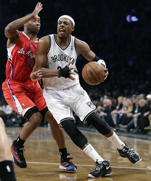 Brooklyn Nets forward Paul Pierce (34) drives up against Los Angeles Clippers guard Willie Green (34) in the first half of their NBA basketball game at the Barclays Center, Thursday, Dec. 12, 2013, in New York. (AP Photo/Kathy Willens)