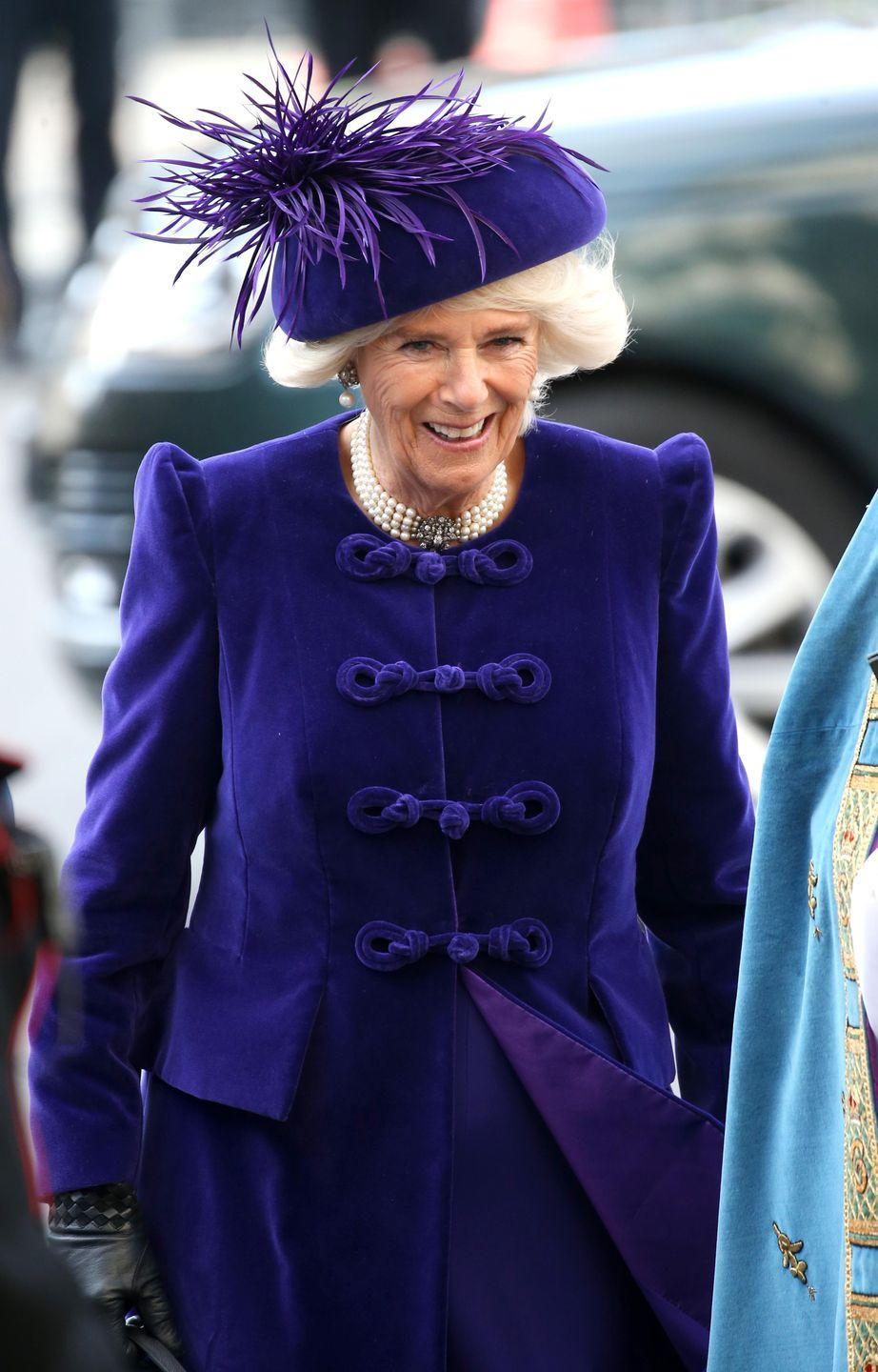<p>The Duchess of Cornwall wore rich royal purple velvet and a matching hued hat with feather plumes to the Commonwealth Day Service at Westminster Abbey.</p>
