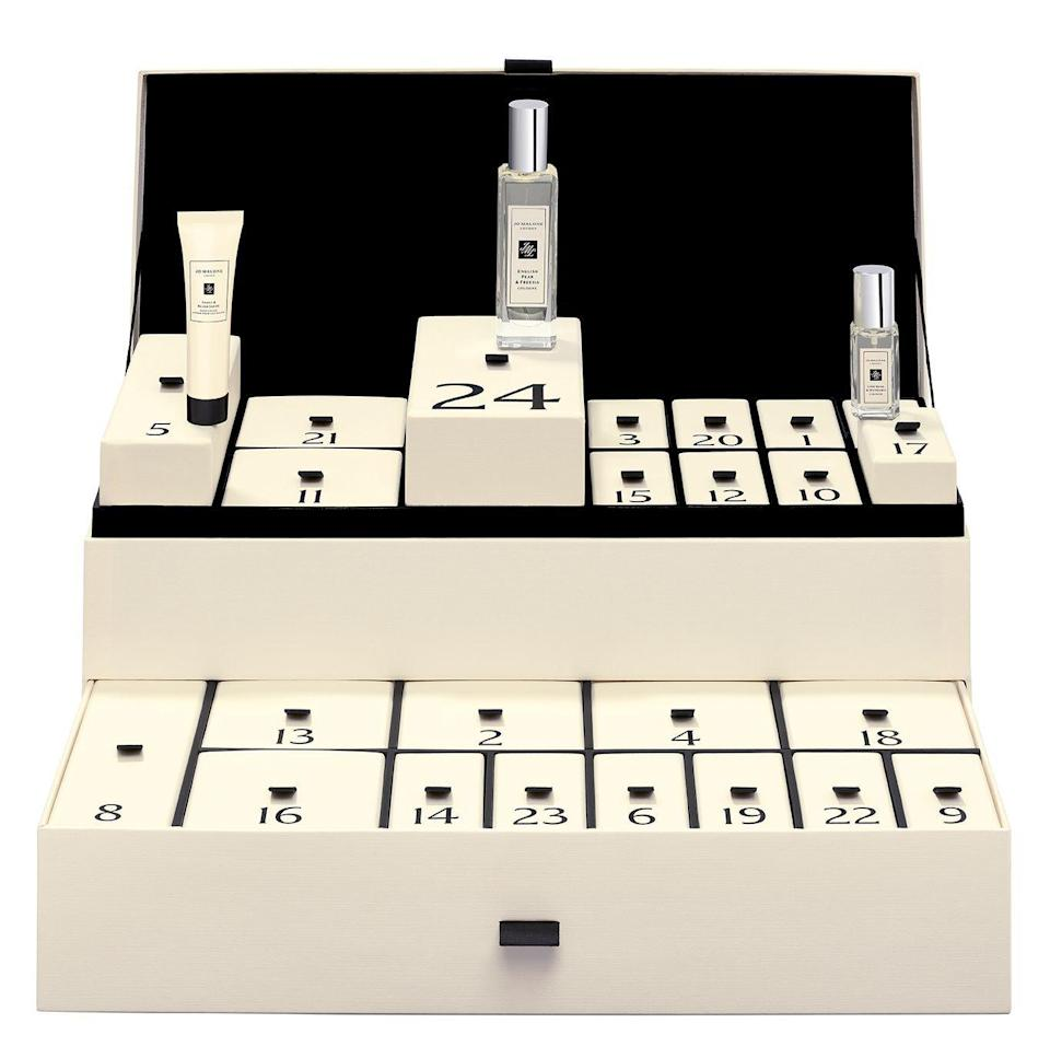 """<p><strong>Jo Malone London</strong></p><p>Jo Malone</p><p><strong>$450.00</strong></p><p><a href=""""https://go.redirectingat.com?id=74968X1596630&url=https%3A%2F%2Fwww.jomalone.com%2Fproduct%2F26322%2F90191%2Fgift-sets%2Fadvent-calendar&sref=https%3A%2F%2Fwww.townandcountrymag.com%2Fstyle%2Ffashion-trends%2Fnews%2Fg2970%2Ffancy-advent-calendars%2F"""" rel=""""nofollow noopener"""" target=""""_blank"""" data-ylk=""""slk:Shop Now"""" class=""""link rapid-noclick-resp"""">Shop Now</a></p><p>If you can't get enough of this London perfumer's famously layerable colognes, this is the perfect advent calendar for you. Filled with 24 of Jo Malone's signature scented products including a 30mL cologne, you'll be smelling sweet all season long. </p>"""