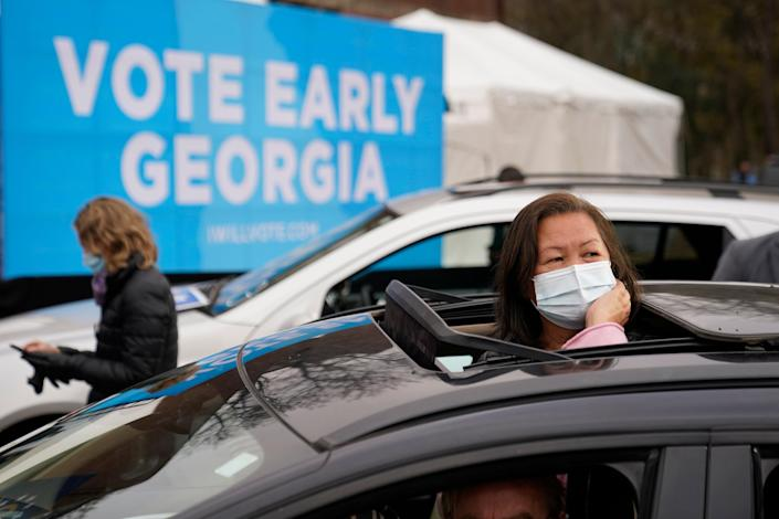 <p>Attendees wait for President-elect Joe Biden to be introduced at a drive-in rally for Georgia Democratic candidates for US Senate Raphael Warnock and Jon Ossoff</p> (Copyright 2020 The Associated Press. All rights reserved.)