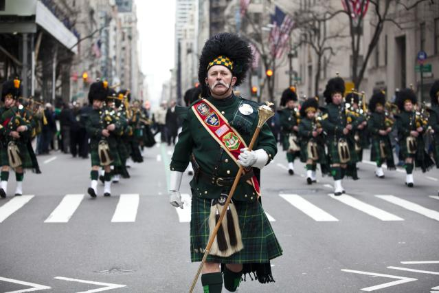 NEW YORK, NY - MARCH 16: A pipes and drums band marches on Fifth Avenue during the 252nd annual St. Patrick's Day Parade March 16, 2013 in New York City. The parade honors the patron saint of Ireland and was held for the first time in New York on March 17, 1762, 14 years before the signing of the Declaration of Independence. (Photo by Ramin Talaie/Getty Images)