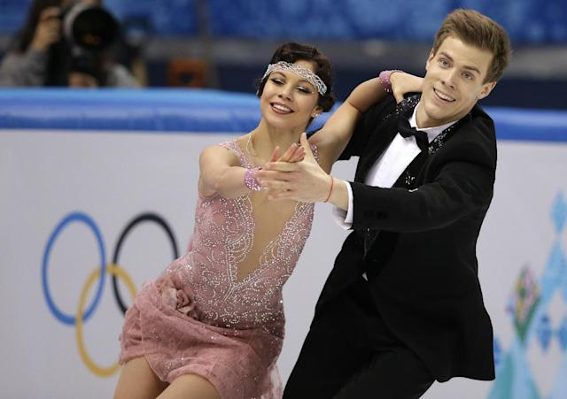 Elena Ilinykh and Nikita Katsalapov of Russia compete in the ice dance short dance figure skating competition at the Iceberg Skating Palace during the 2014 Winter Olympics, Sunday, Feb. 16, 2014, in Sochi, Russia. (AP Photo/Darron Cummings)