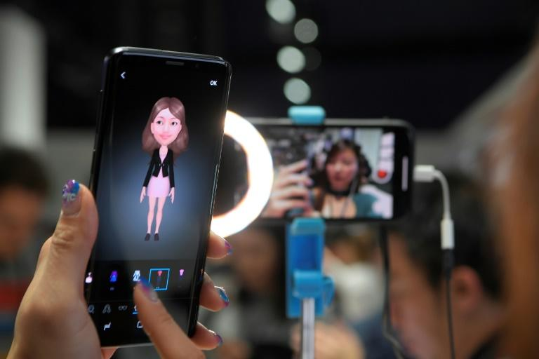 A woman checks a new Samsung Galaxy S9 mobile phone