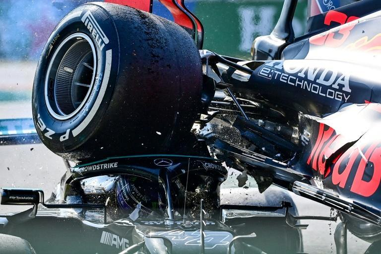 Lewis Hamilton's Italian Grand Prix ended with Max Verstappen's car on his head (AFP/ANDREJ ISAKOVIC)