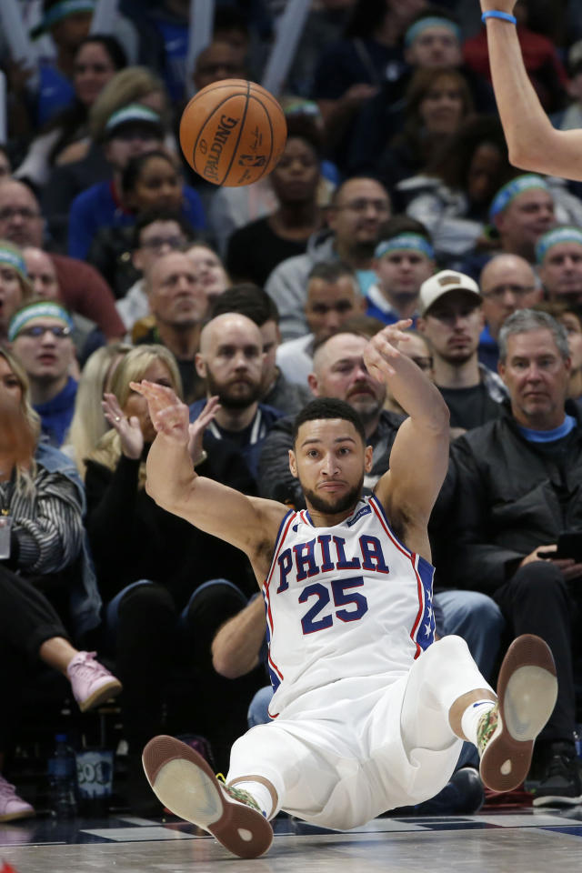 Philadelphia 76ers guard Ben Simmons (25) falls the floor after being fouled by a Dallas Mavericks player during the second half of an NBA basketball game in Dallas, Saturday, Jan 11, 2020. (AP Photo/Michael Ainsworth)