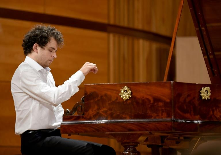 """Competitor French pianist Benjamin d'Anfray says playing the antique pianos, with their technical differences to modern ones, is like being """"sucked into another world"""""""