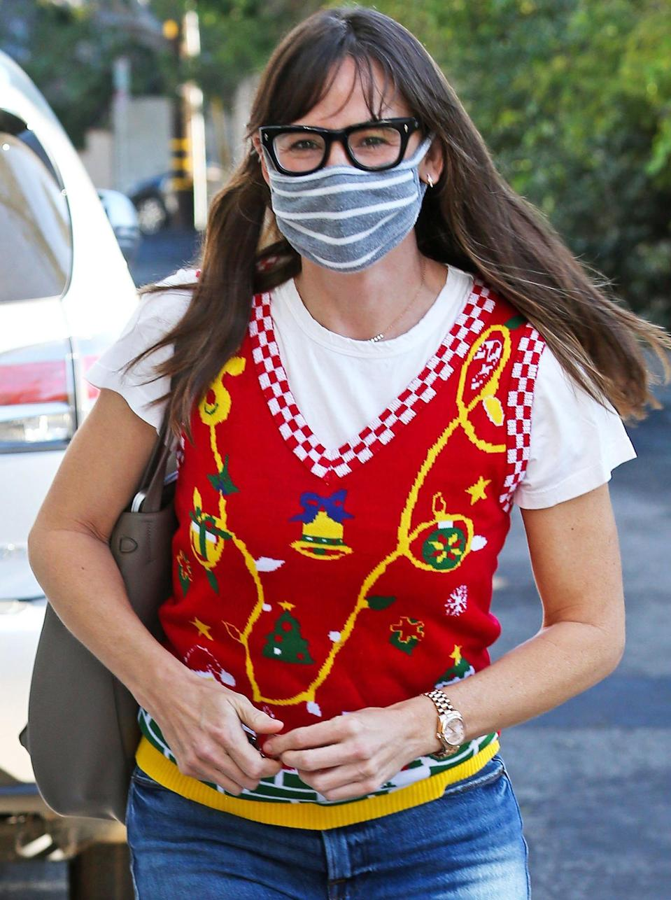 <p>Jennifer Garner wore a Christmas vest while out and about in Brentwood, California.</p>