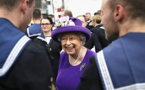 Queen Elizabeth II attends the Commissioning Ceremony of HMS Queen Elizabeth at HM Naval Base - Credit:  Chris Jackson/Getty
