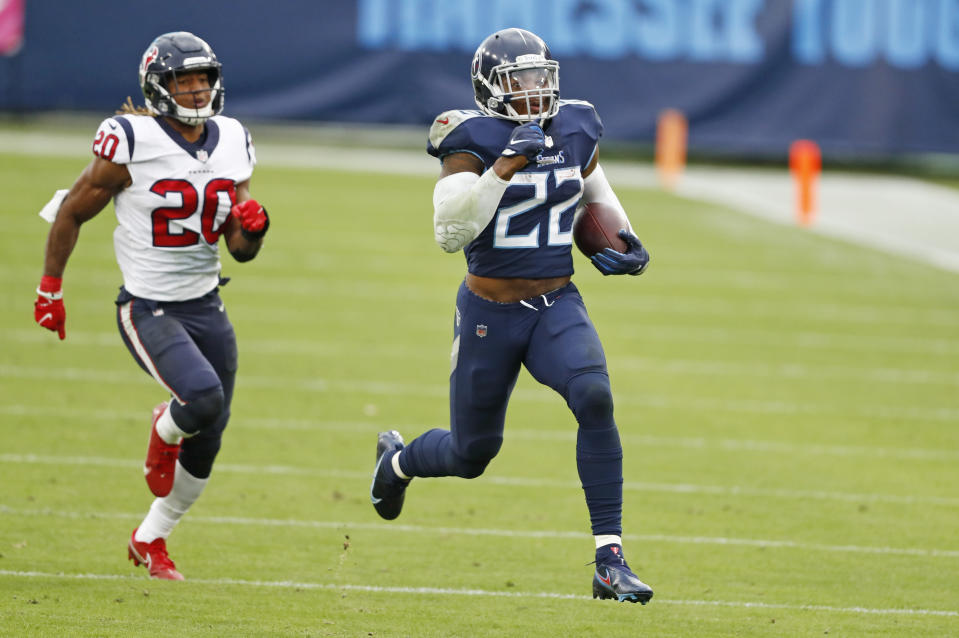 Tennessee Titans running back Derrick Henry (22) beats Houston Texans strong safety Justin Reid (20) as Henry runs 94 yards for a touchdown. (AP Photo/Wade Payne)