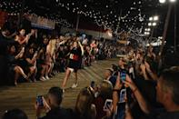 <p>In a bid to make the show as open as possible, Hilfiger invited 2000 members of the public to watch the show on the boardwalk.<br><i>[Photo: Getty]</i> </p>