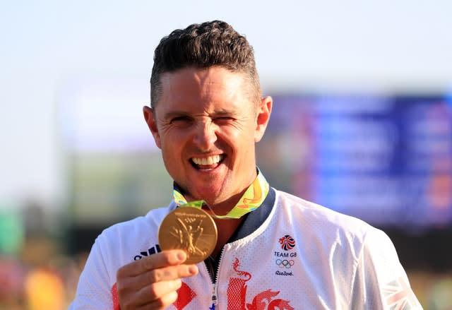 Justin Rose celebrates with his Olympic gold medal in Rio (Mike Egerton/PA)