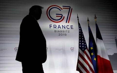 US President Donald Trump at the G7 summit  - Credit: CARLOS BARRIA/REUTERS