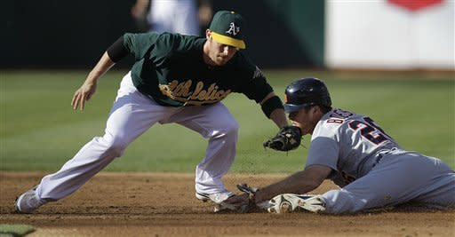 Detroit Tigers' Brennan Boesch, right, steals second base beneath the tag of Oakland Athletics shortstop Eric Sogard during the second inning of a baseball game, Saturday, May 12, 2012, in Oakland, Calif. (AP Photo/Ben Margot)