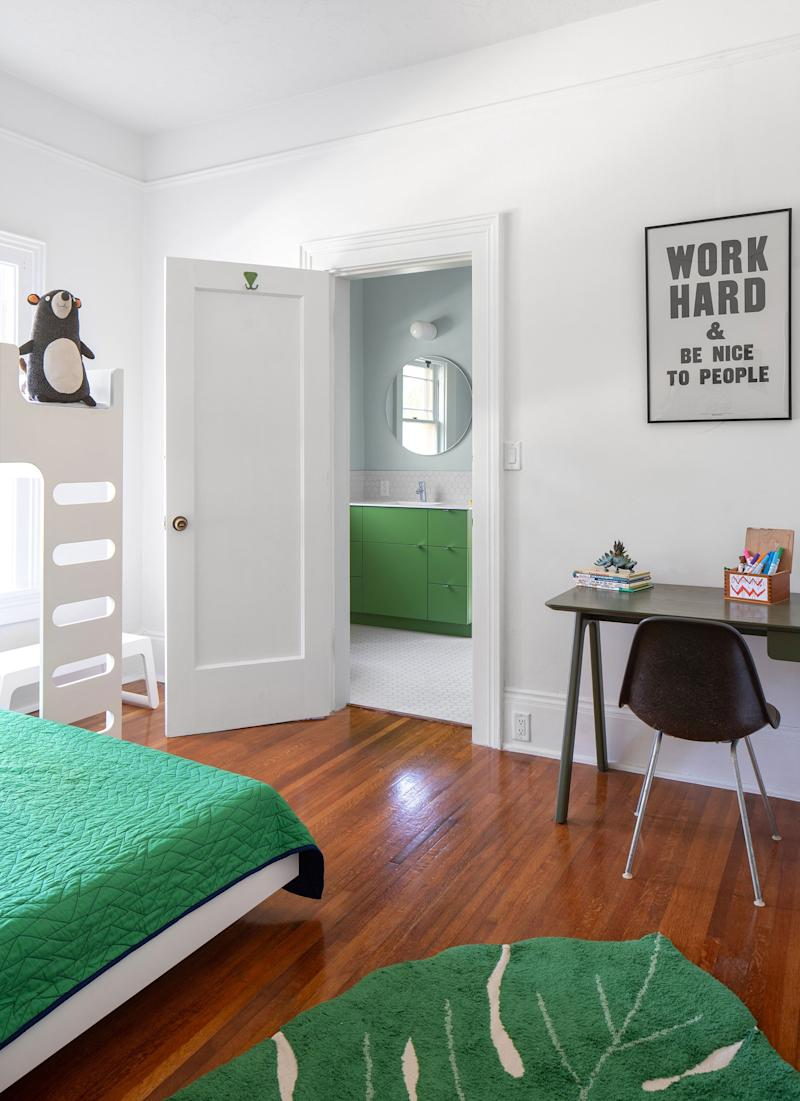 The kids' bedroom maintains the bright white walls but is full of bright pops of green, which carry through into the bathroom. The cool, modern bunk bed is from Rafa Kids.