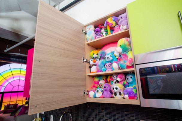 PHOTO: The Lisa Frank Flat offers guests cabinets filled with stuffed animals. (via Hotels.com)