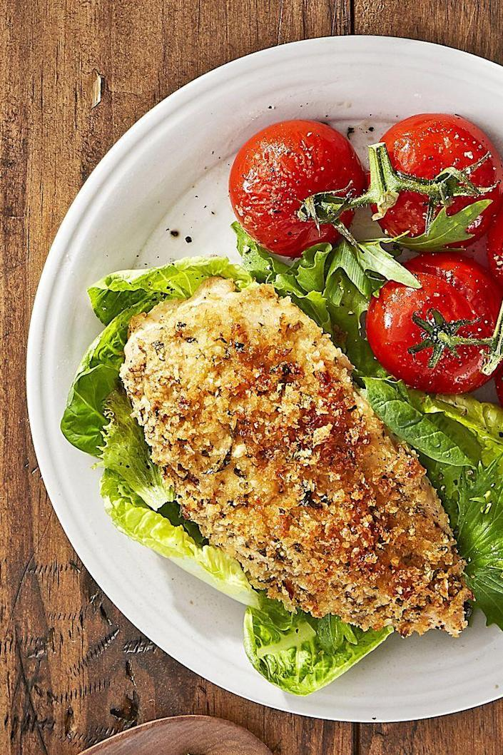 """<p>The secret behind this flavorful recipe? A smear of Dijon mustard on each chicken breast!</p><p><strong><a href=""""https://www.countryliving.com/food-drinks/recipes/a44271/roasted-parmesan-chicken-tomatoes-recipe/"""" rel=""""nofollow noopener"""" target=""""_blank"""" data-ylk=""""slk:Get the recipe"""" class=""""link rapid-noclick-resp"""">Get the recipe</a>.</strong></p><p><strong><a class=""""link rapid-noclick-resp"""" href=""""https://www.amazon.com/Nordic-Ware-Natural-Aluminum-Commercial/dp/B0049C2S32?tag=syn-yahoo-20&ascsubtag=%5Bartid%7C10063.g.35055779%5Bsrc%7Cyahoo-us"""" rel=""""nofollow noopener"""" target=""""_blank"""" data-ylk=""""slk:SHOP BAKING SHEETS"""">SHOP BAKING SHEETS</a><br></strong></p>"""