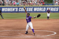 James Madison's Odicci Alexander pitches in the first inning of an NCAA Women's College World Series softball game against Oklahoma, Monday, June 7, 2021, in Oklahoma City. (AP Photo/Sue Ogrocki)
