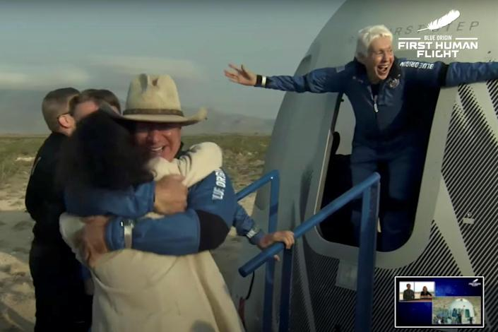 Jeff Bezos and Wally Funk emerge from their capsule after their flight aboard Blue Origin's New Shepard rocket near Van Horn, Texas, on Tuesday, July 20, 2021 in a still image from video. / Credit: BLUE ORIGIN
