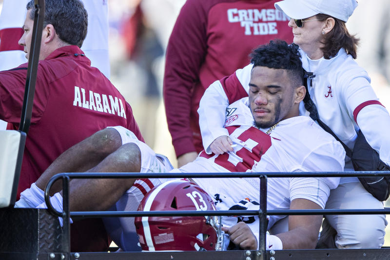 Alabama's Tua Tagovailoa is helped off the field after being injured on a play in the first half against the Mississippi State Bulldogs. (Wesley Hitt/Getty Images)