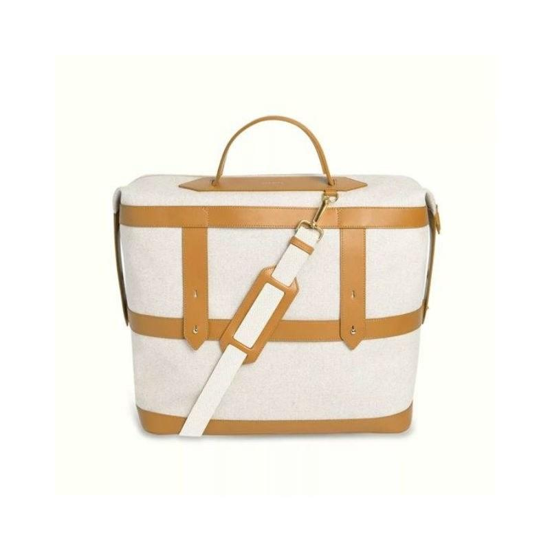 """<p>Designed to be the perfect size for a weekend getaway, this canvas cotton tote comes in three colors, and also happens to be fully customizable. (You can add an embroidered monogram in a square created by the leather accents for a practical gift the jet-setter in your life is sure to love.)</p> <p><strong>$295</strong> (<a href=""""https://click.linksynergy.com/deeplink?id=MZ9491VLjxM&mid=43748&u1=allureGGuniquegifts&murl=https%3A%2F%2Ftourparavel.com%2Fcollections%2Fwomen%2Fproducts%2Fweekender%3Fvariant%3D16446883496025%23"""" rel=""""nofollow"""">Shop Now</a>)</p>"""