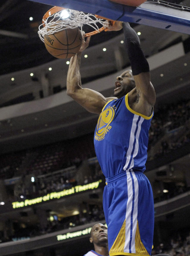 Golden State Warriors' Andre Iguodala dunks on a fast-break during the first half of an NBA basketball game against the Philadelphia 76ers on Monday, Nov. 4, 2013, in Philadelphia. (AP Photo/Michael Perez)