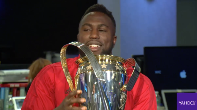 Jozy Altidore at Yahoo with the MLS trophy
