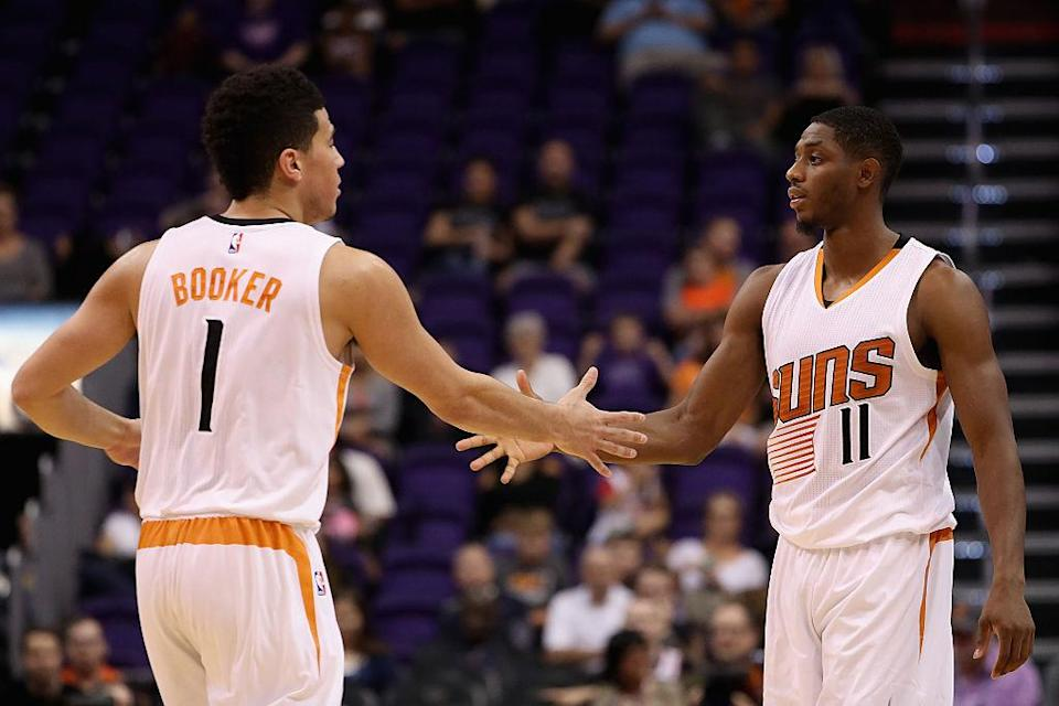 Devin Booker (left) and Brandon Knight stuff the stat sheet. (Christian Petersen/Getty Images)