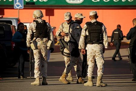 A soldier keeps watch at a crime scene after unknown assailants attacked and injured a policewoman, in Ciudad Juarez