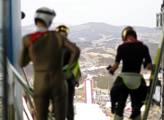 Nordic Combined Events - Pyeongchang 2018 Winter Olympics - Ski Jumping Training - Alpensia Ski Jumping Centre - Pyeongchang, South Korea - February 19, 2018 - Athletes wait before their jump. REUTERS/Dominic Ebenbichler