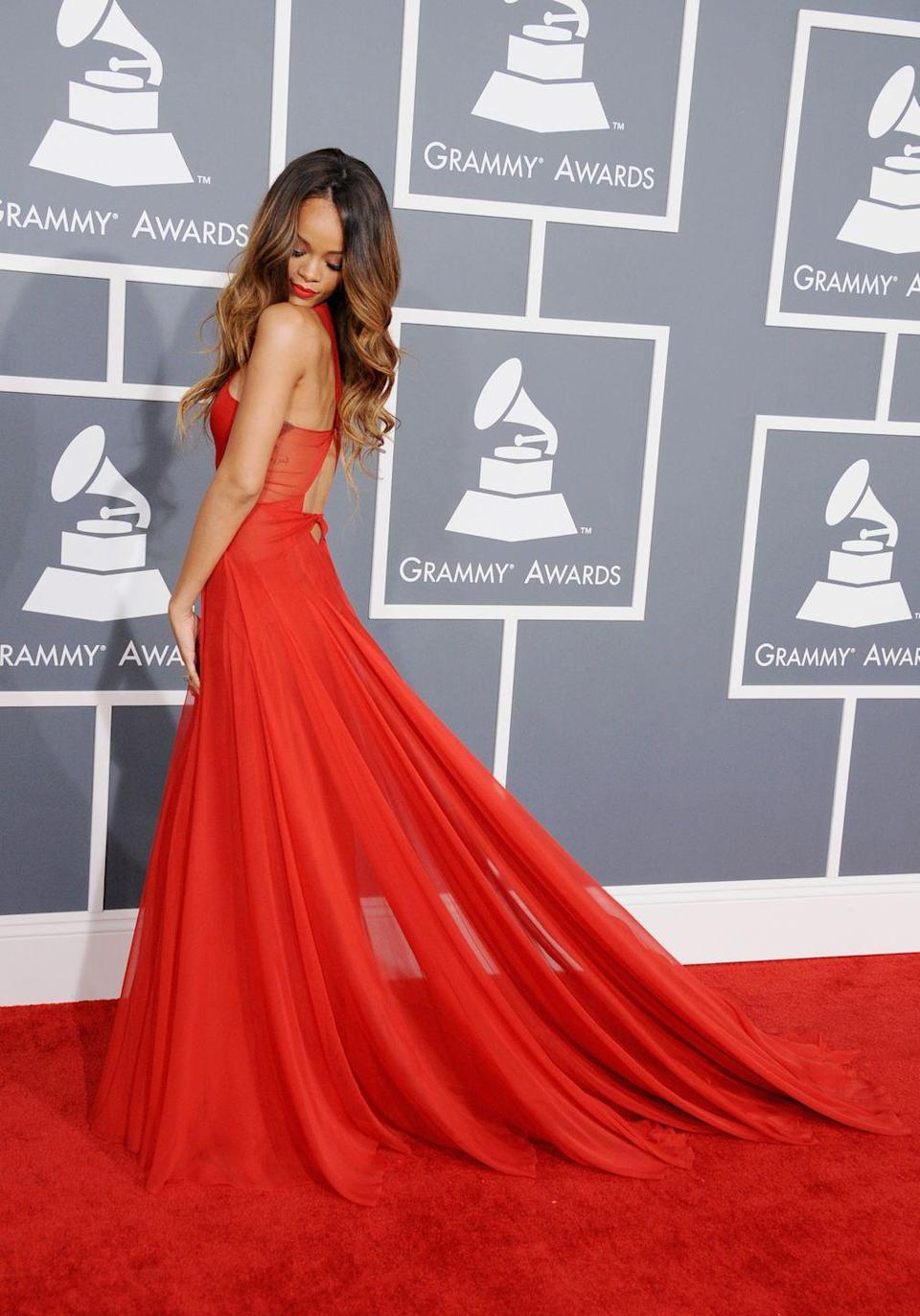 <p>One of Rihanna's earlier memorable red carpet moments - and, arguably, one of her most romantic - was the sheer red chiffon Azzedine Alaia gown she wore to the 2013 Grammys. With her hair in cascading curls and a matching red lip, the look was feminine, sexy and show-stopping.</p>